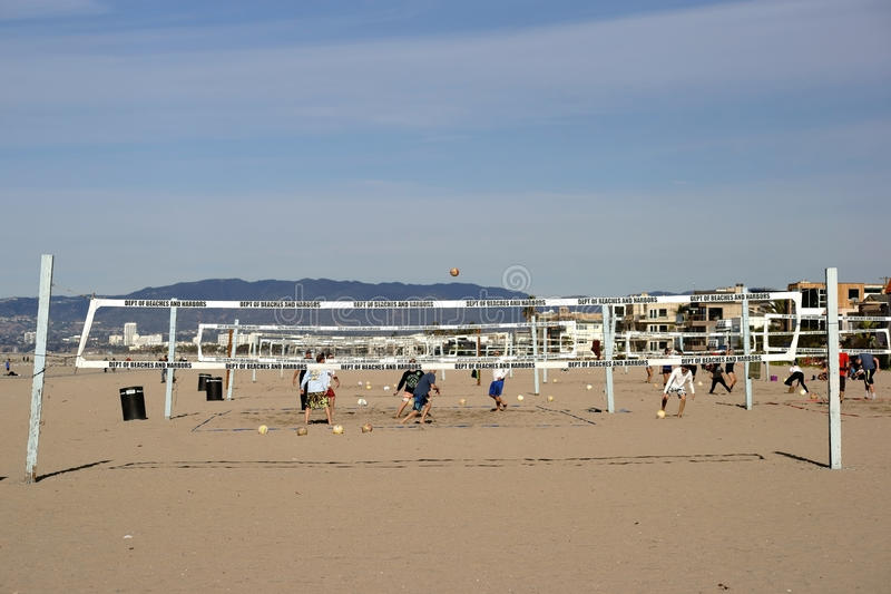 Beach Volleyball. Long Beach, United States - December 26, 2015: Volleyball player playing Volleyball on a beach volleyball court on the beach in Long Beach on stock photography