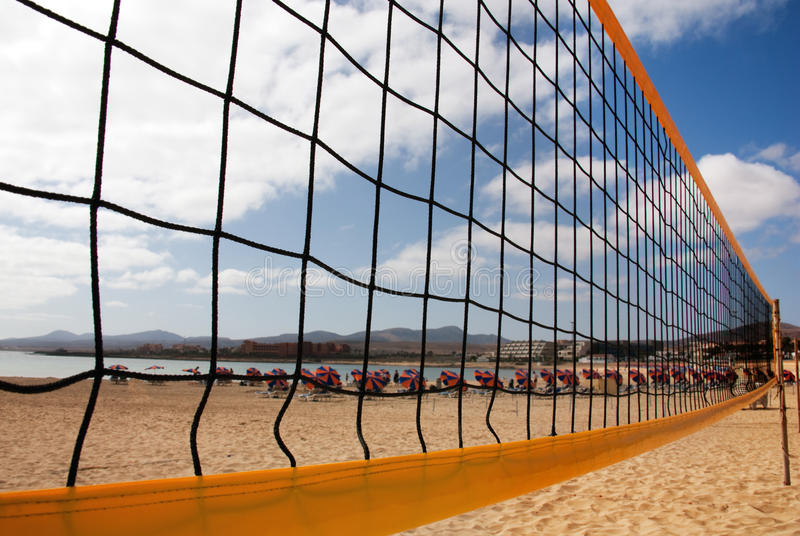 Beach volleyball net and beach royalty free stock photos