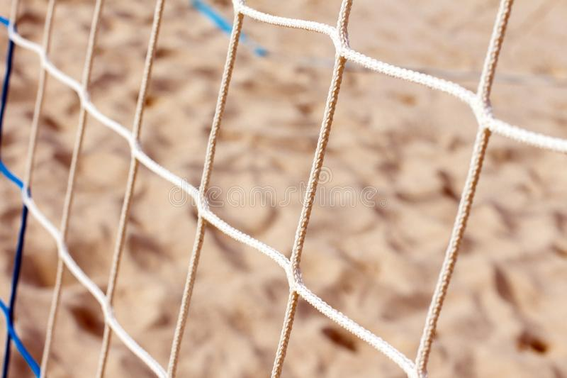 Beach volleyball net on sand background, close-up. Background royalty free stock photography