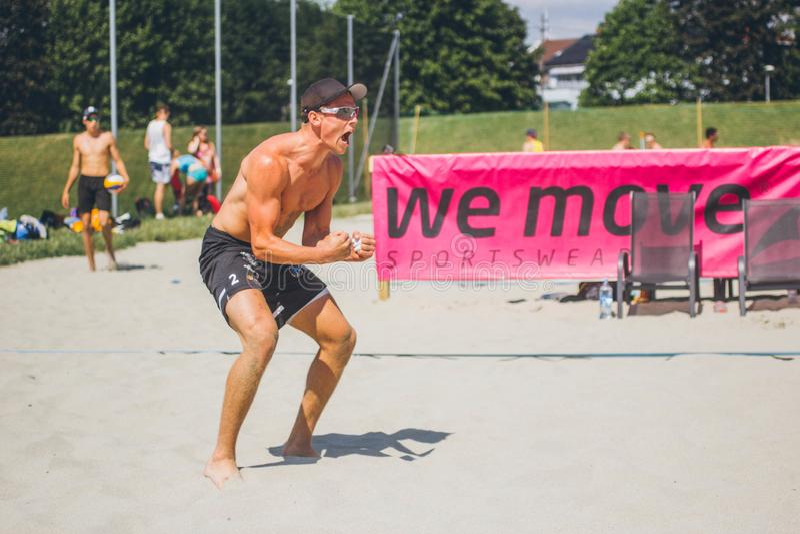 Beach volleyball player cheering stock photo