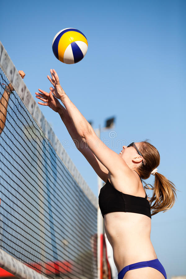 Beach volleyball woman blocking. Block at the net. stock images