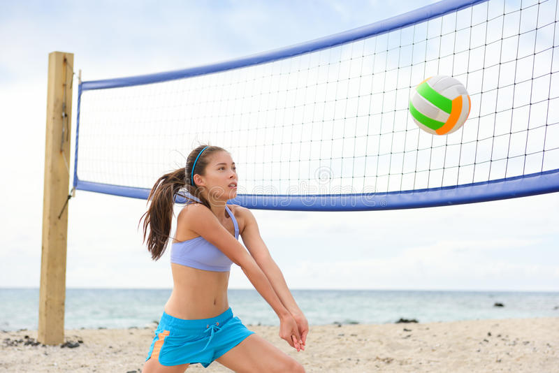 Beach volleyball woman playing game hitting ball. Beach volleyball woman playing game hitting forearm pass volley ball during match on summer beach. Female model royalty free stock photos
