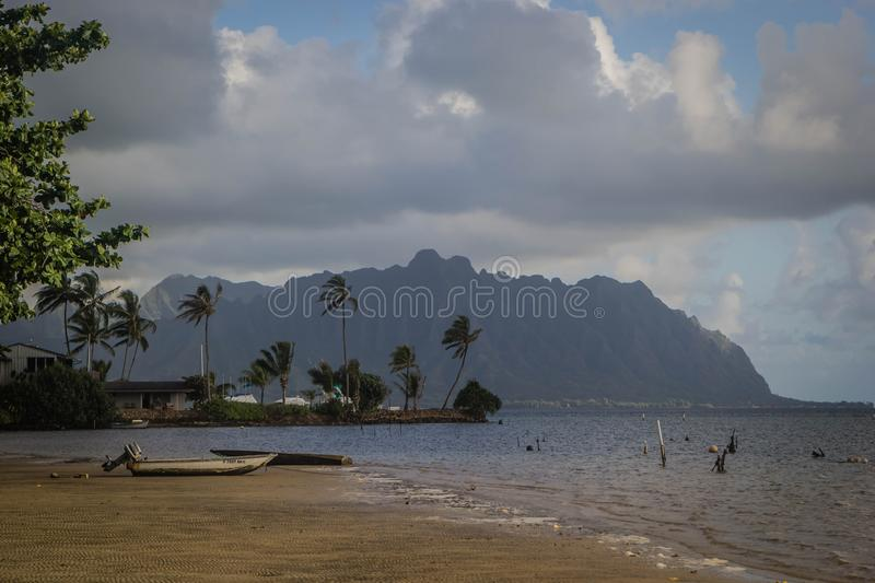 Beach of Waimanalo during misty weather with breathtaking large grey clouds in the sky royalty free stock photography