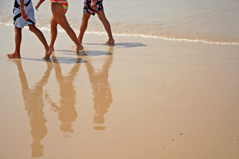 Beach walkers stock photos