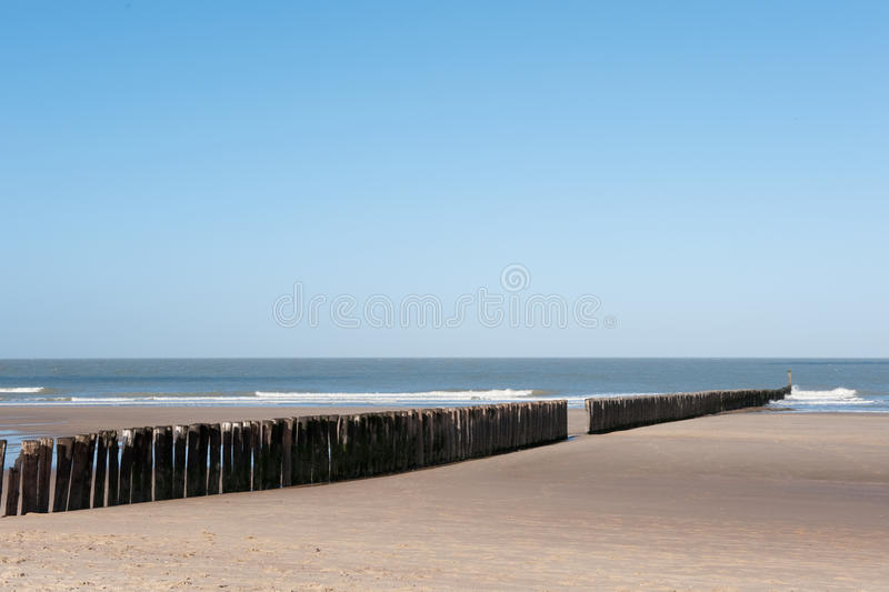 Beach with wave breaker stock photography