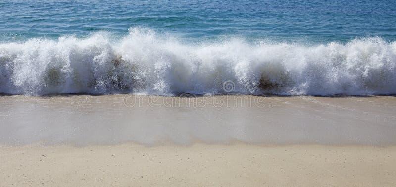 Beach wave closeup stock image