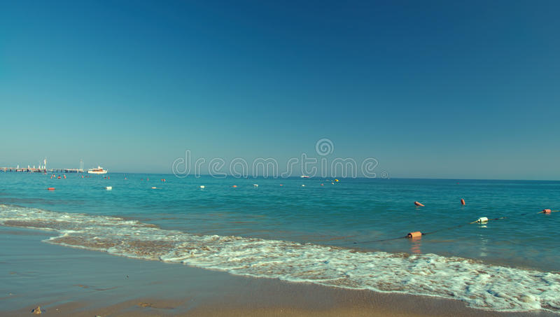 Beach with waves. At the Mediterranean Resort Antalya Turkey stock images