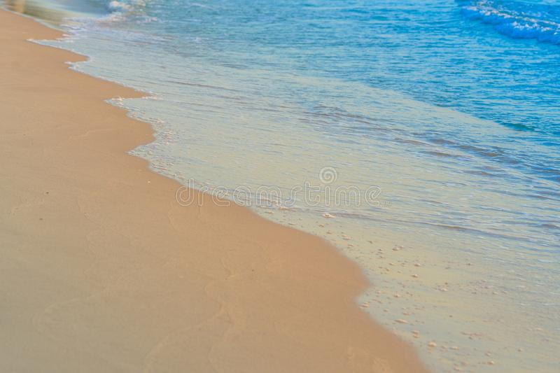 Beach waves on sand day time stock photo