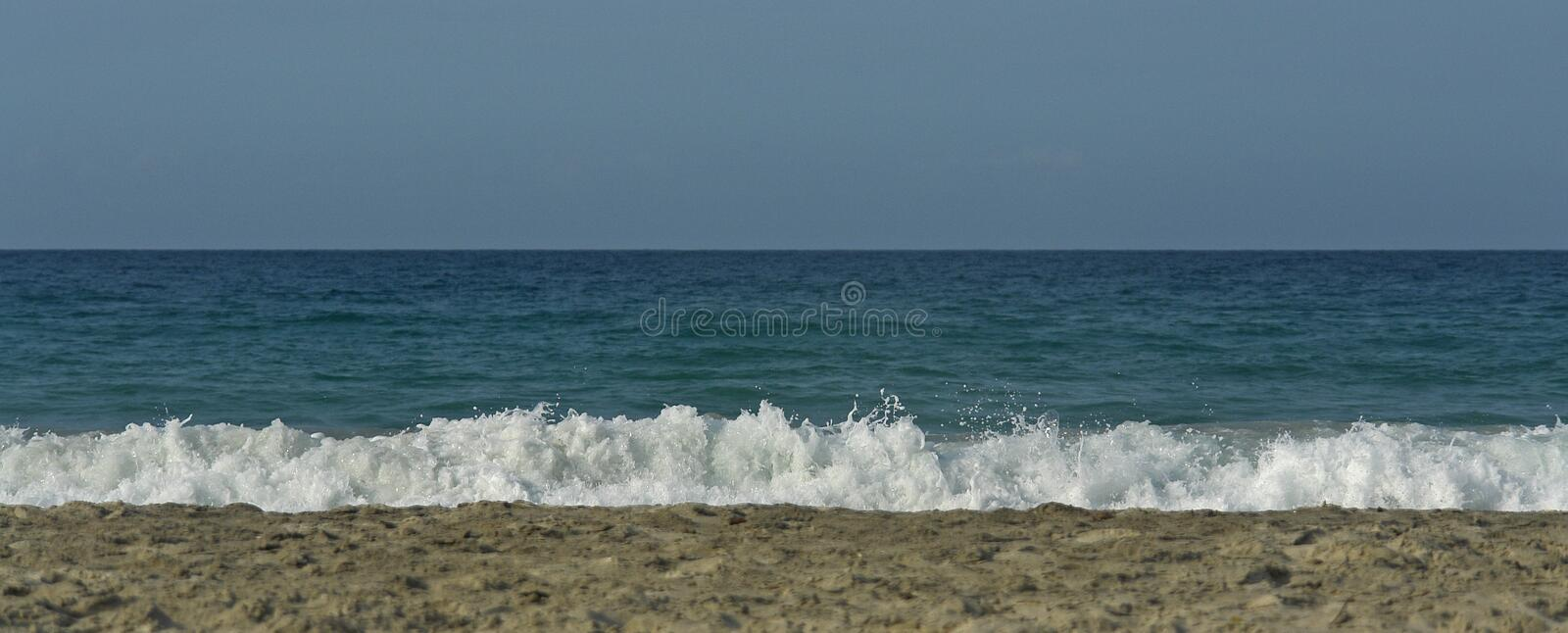 Beach with waves stock photo