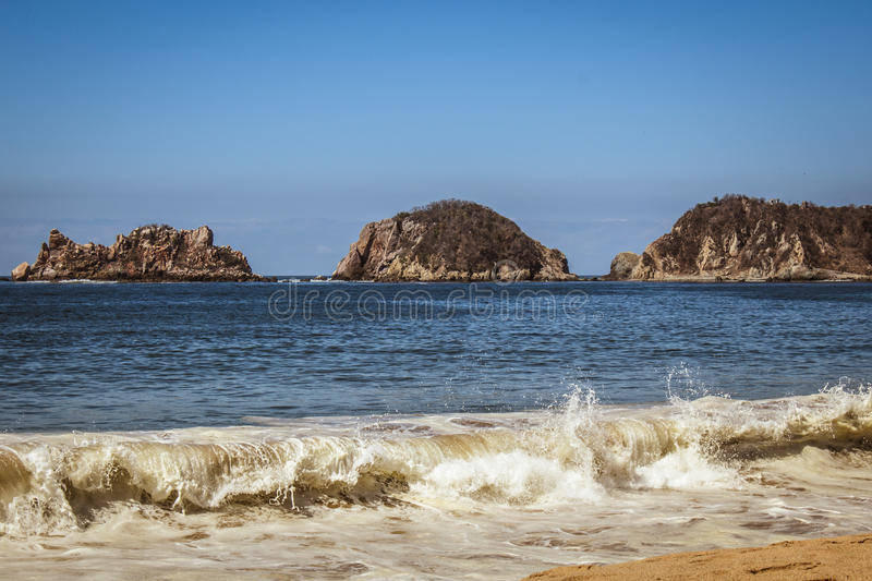 Beach. The waves at the sun raising of manzanillo stock image