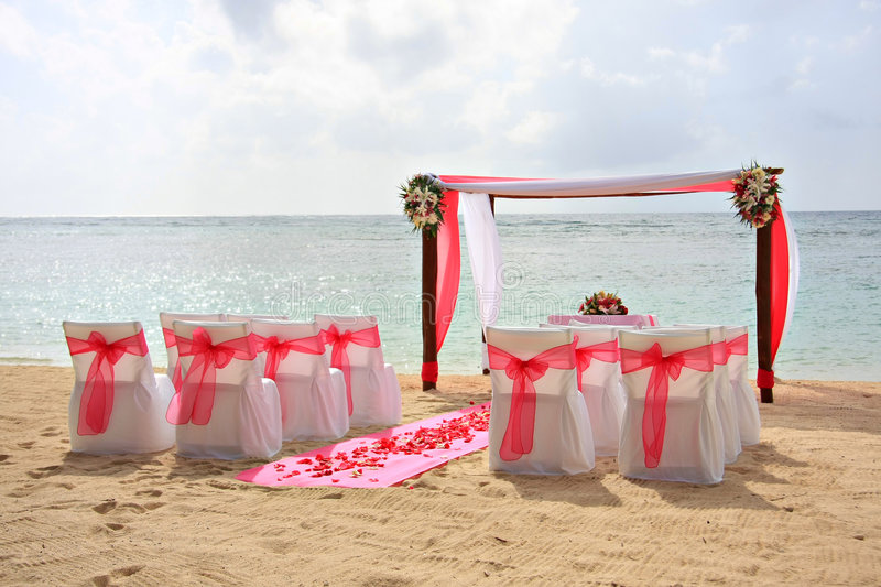 Beach wedding. Gazebo and chairs set up for a romantic beach wedding royalty free stock image