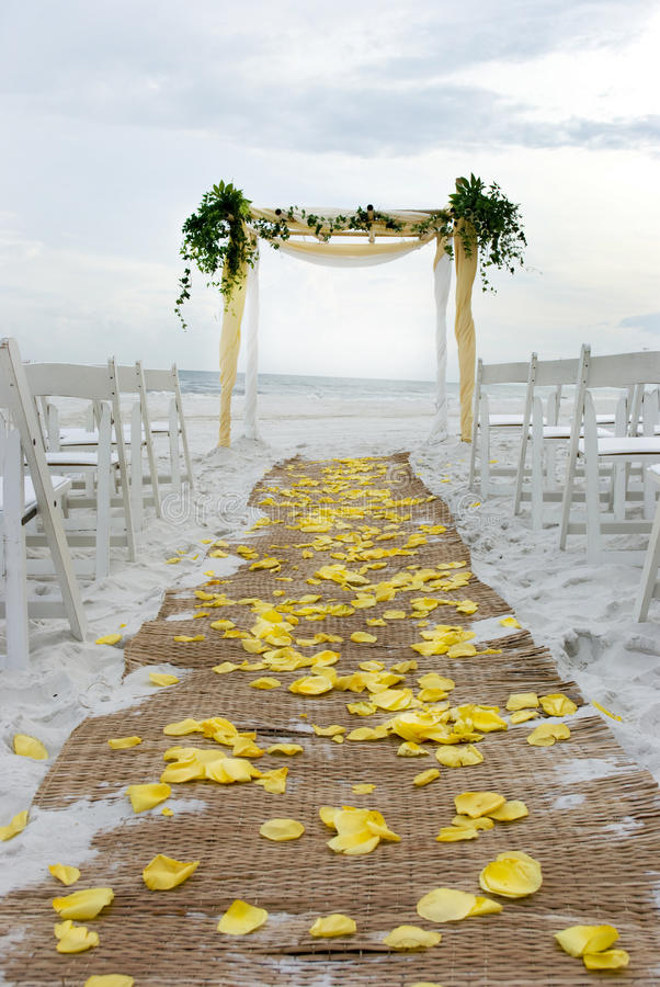Beach Wedding Aisle. Aisle for a beach wedding strewn with yellow rose petals royalty free stock images