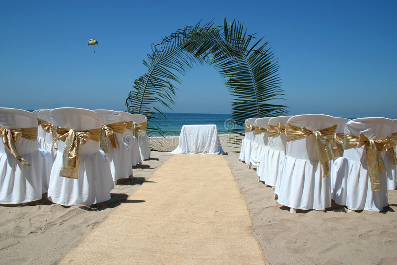 Beach Wedding With Chairs, Palm Arch And Ocean In
