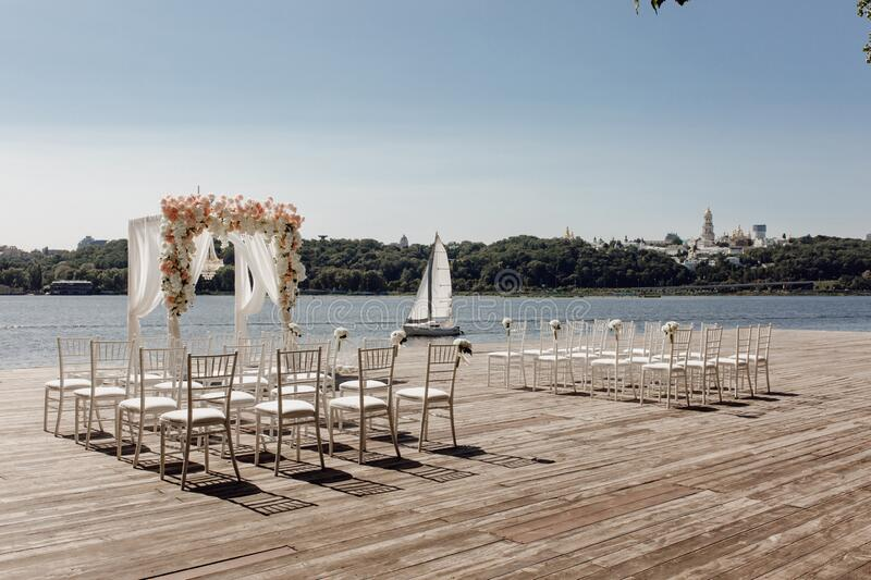 Beach Wedding Day Venue Arch Altar and Chairs stock images