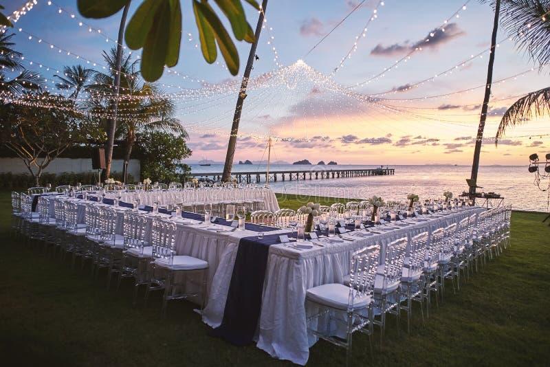 Beach wedding reception dinner venue setting ar sunset stock photos