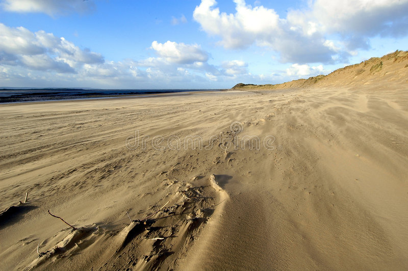 Download Beach in the Wind stock image. Image of clouds, winter, devon - 75041