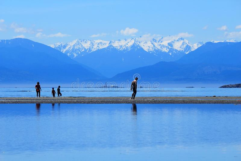 Beach at Witty`s Lagoon with Olympic Mountains as Backdrop, Vancouver Island, British Columbia stock images