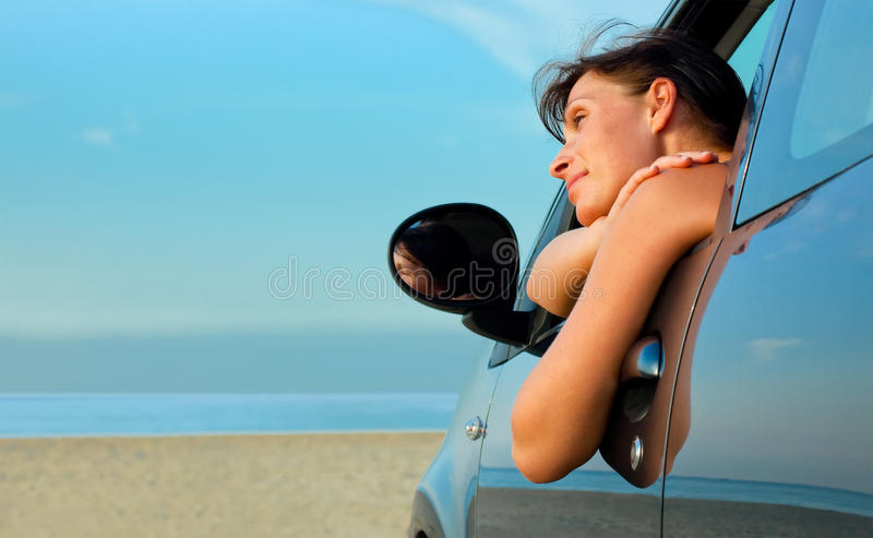 Beach woman car stock photos