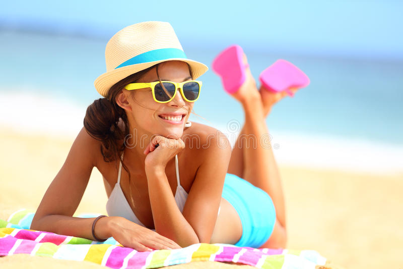 Beach woman funky happy and colorful. Wearing sunglasses and beach hat having summer fun during travel holidays vacation. Young multiracial trendy cool hipster royalty free stock images