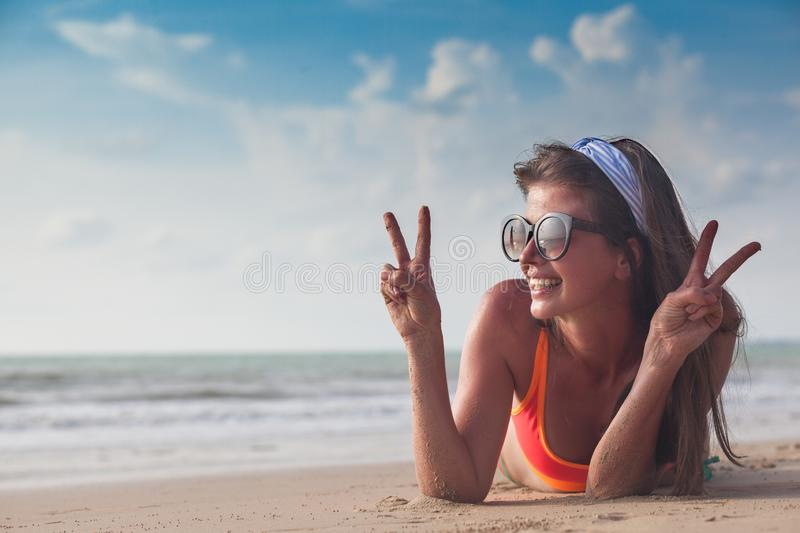 Beach woman funky happy and colorful wearing sunglasses having summer fun during travel holidays vacation. Young trendy royalty free stock photos