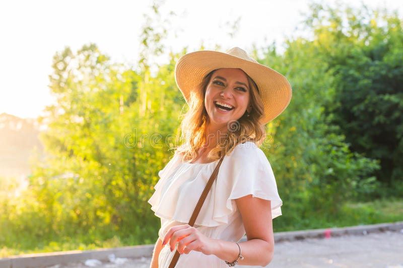 Beach woman laughing having fun in summer vacation holidays. Girl wearing big straw hat stock photos