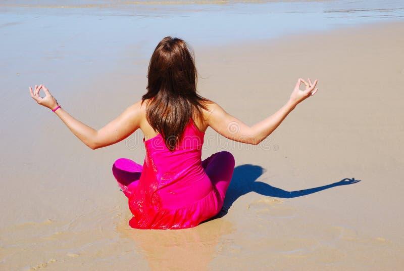 Beach woman worshipping stock image
