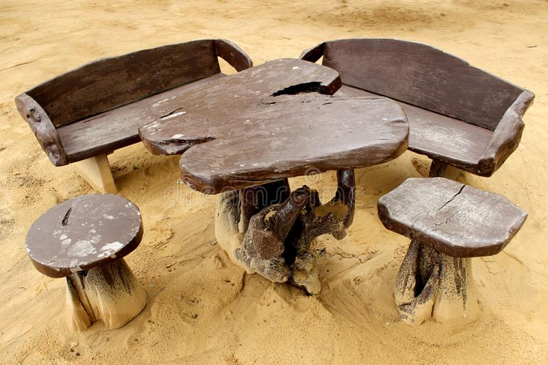 Beach wooden table and chairs stock images