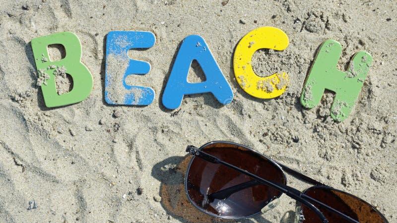 Download Beach written stock photo. Image of sand, sunglasses - 33358320