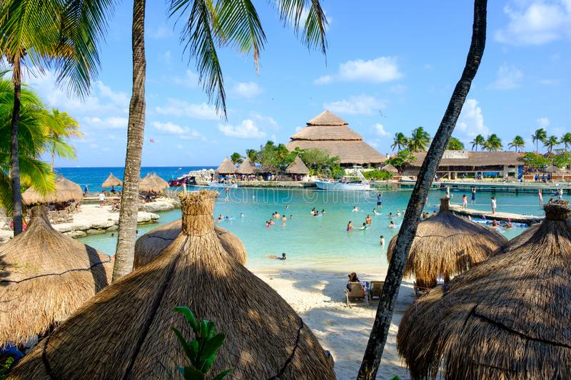 The beach at XCaret Park on the Mayan Riviera in Mexico. XCARET,MEXICO - APRIL 16,2019 : The beach area at XCaret Park on the Mayan Riviera on a beautiful sunny stock images