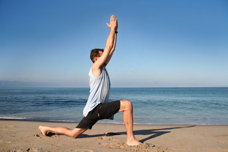 Beach yoga stock photos