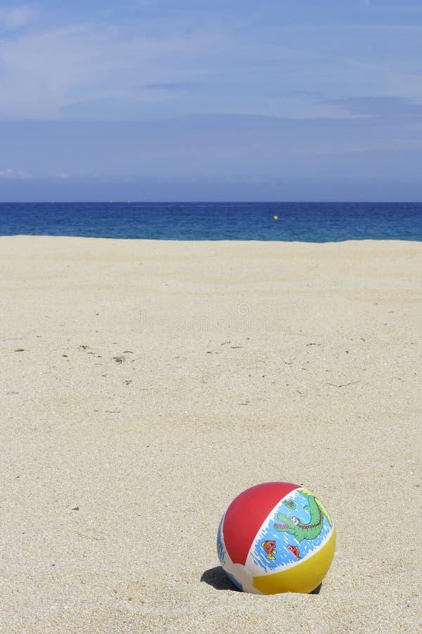 Beachball on empty sandy beach. A beachball on empty sandy beach in Corsica stock photos