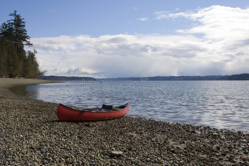 Beached Canoe royalty free stock images