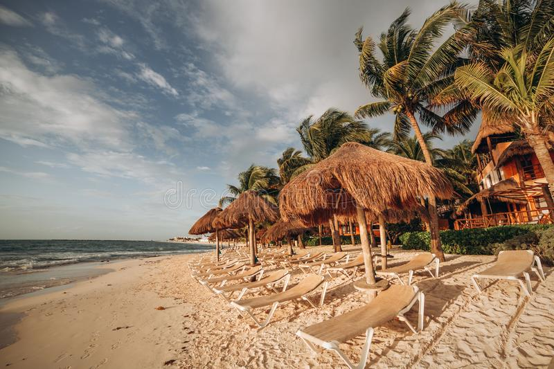 Beaches in the Caribbean. Concept for rest, relaxation, holidays, spa, resort. Chaise lounges under canopies on the royalty free stock images