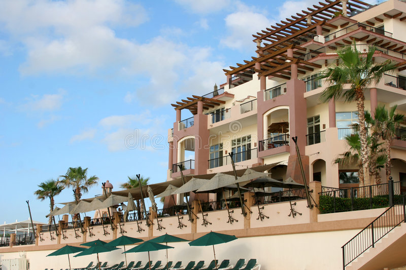 Beachfront Hotel. An upscale resort viewed from the beach in Cabo San Lucas, Mexico stock photography