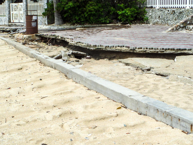 Beachfront road boardwalk damaged by storm surge. Beachfront road and boardwalk damaged by storm surge stock photos