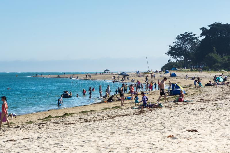 Beachgoers on Inverloch beach in South Gippsland in Australia. Inverloch, Australia - January 27, 2018: Beachgoers on Inverloch beach, a popular seaside holiday royalty free stock photography