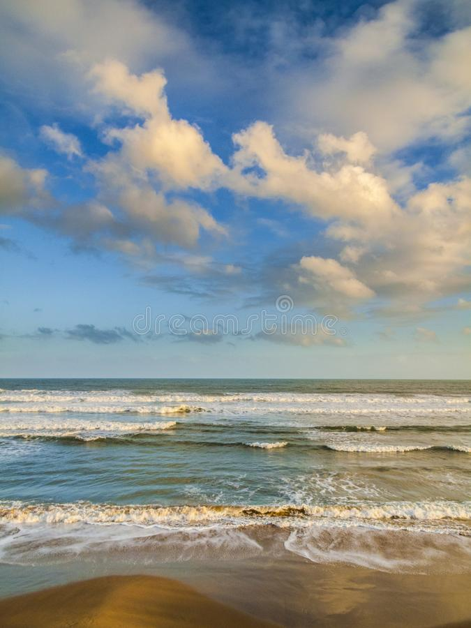Beachscape with incoming waves looking out to sea. At dawn or dusk royalty free stock photography