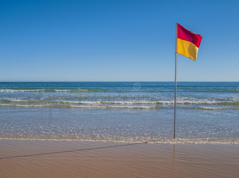 Beachscape with safe swimming flag in Australia royalty free stock photo