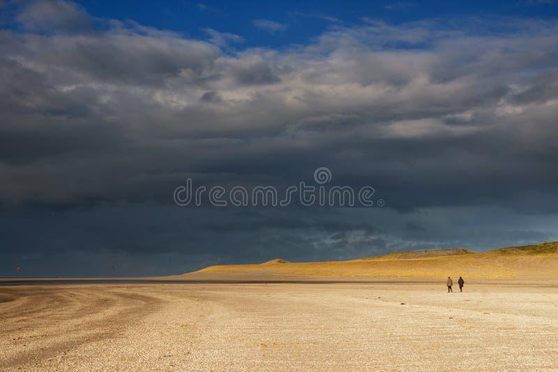 Beachwalk on the Maasvlaktestrand royalty free stock photography