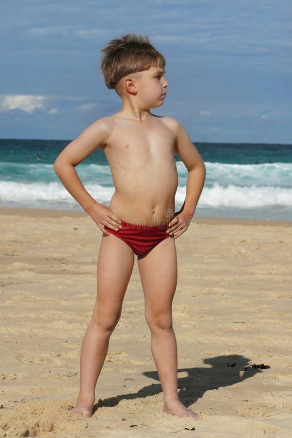Beachy days. A young boy at the beach stock photos