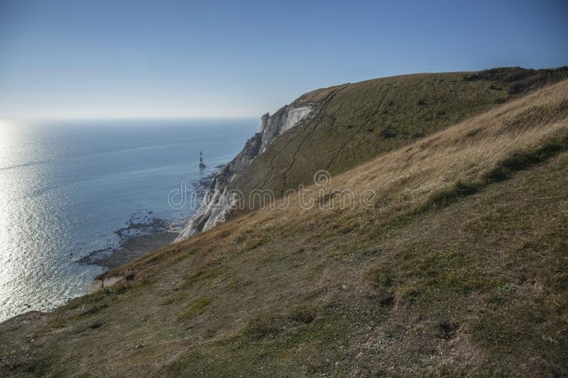 Beachy Head cliffs, East Sussex - seas, skies and meadows. This image shows a view of Beachy Head cliffs in East Sussex, England, the UK. It was taken on a stock images
