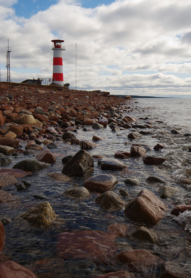 Beacon on coast of northern sea. Beacon on coast of cold northern sea royalty free stock image