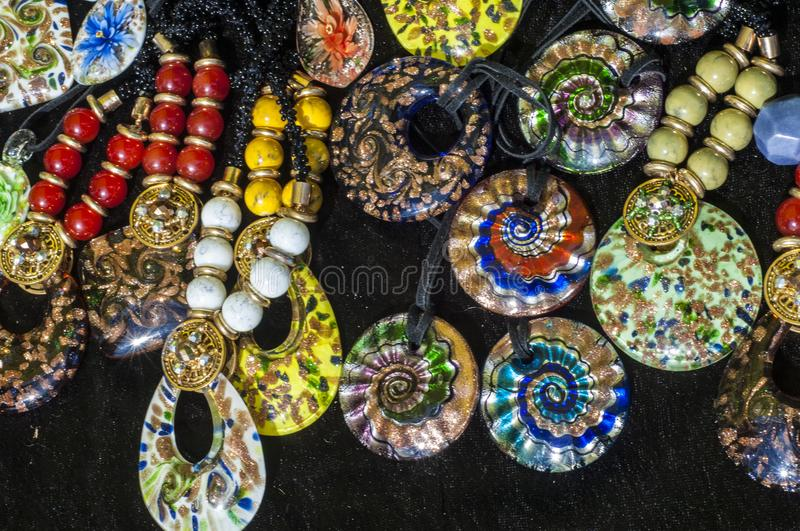 Bead, chaplet, beading. A small piece of glass, stone, or similar material, typically rounded and perforated for threading with others as a necklace royalty free stock image