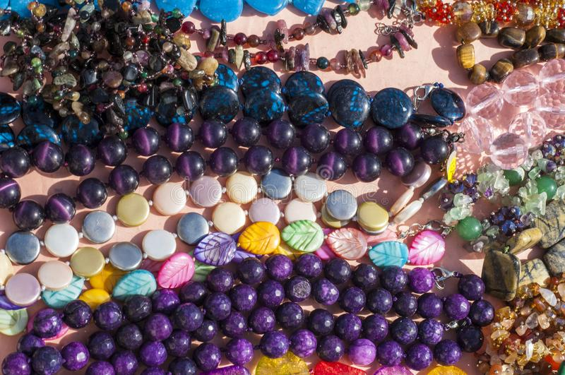 Bead, chaplet, beading. A small piece of glass, stone, or similar material, typically rounded and perforated for threading with others as a necklace royalty free stock photo