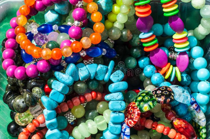 Bead, chaplet, beading. Texture, background. a small piece of glass, stone, or similar material, typically rounded and perforated for threading with others as stock image
