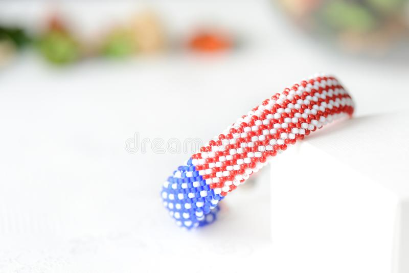 Bead crochet bracelet in colors of american flag. Close up royalty free stock photography