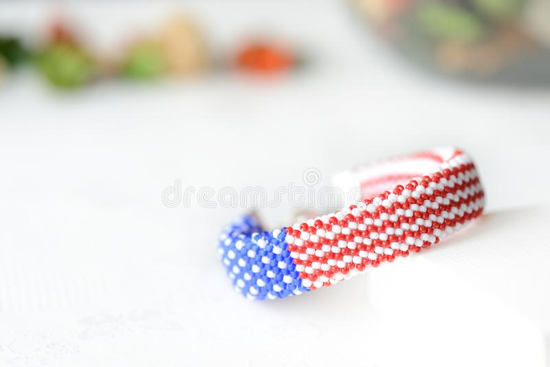 Bead crochet bracelet in colors of american flag. Close up royalty free stock image