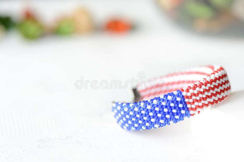 Bead crochet bracelet in colors of american flag. Close up stock photos
