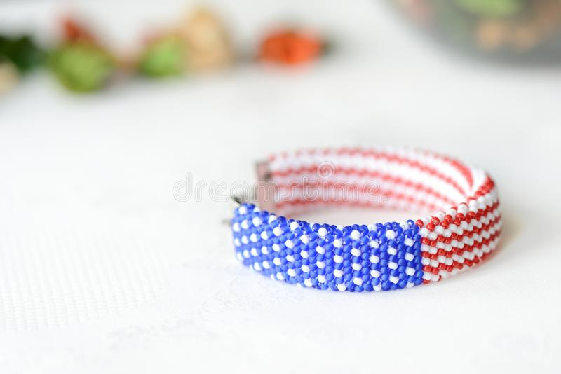 Bead crochet bracelet in colors of american flag. Close up stock image