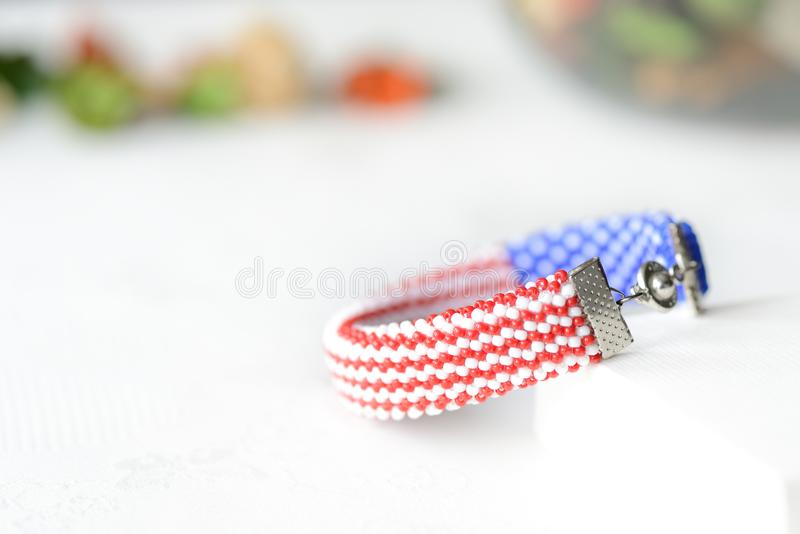 Bead crochet bracelet in colors of american flag. Close up royalty free stock images